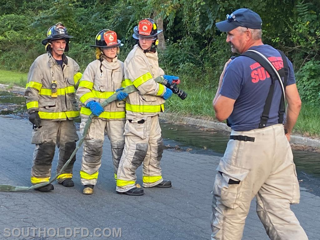 Carmine assisting Bill during the hose handling drill. Probys Courtney and Parker (center) get hands-on experience.