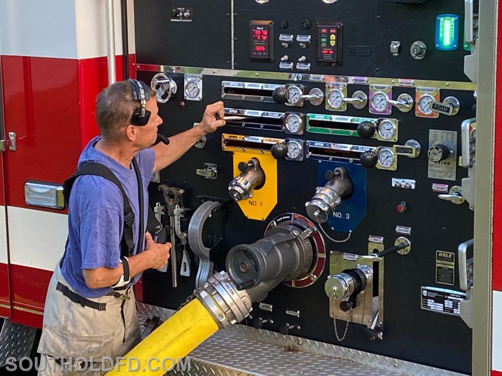 John Roslak controls the water pressure.