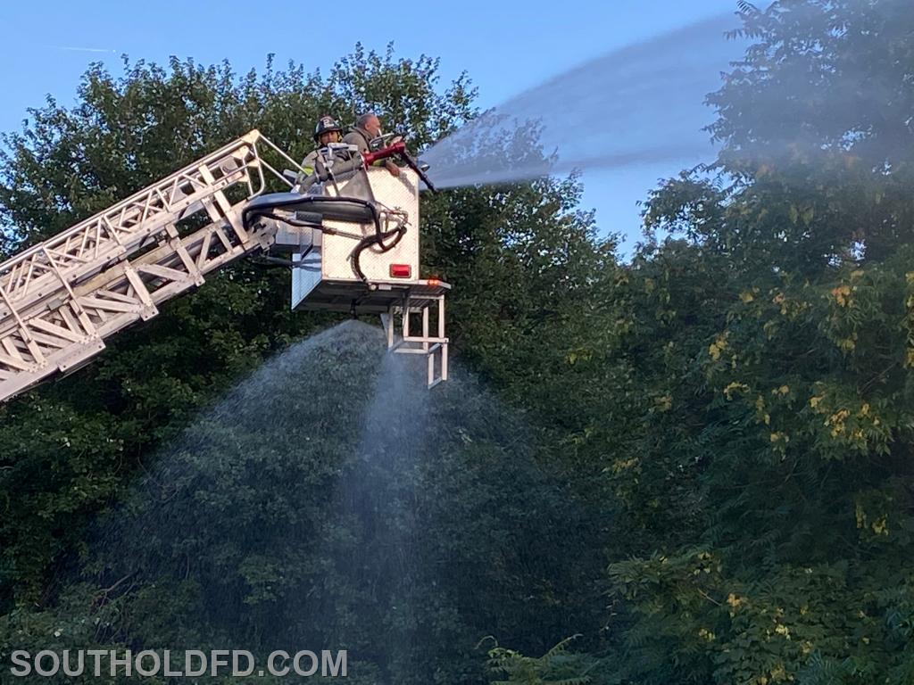 Using the fog setting on the ladder truck bucket nozzle.