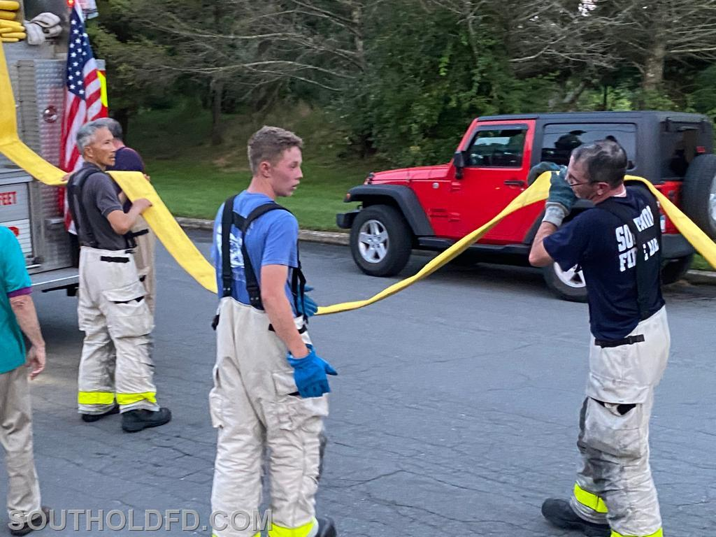 Fred, Parker and Jon help with the final LDH hose section.